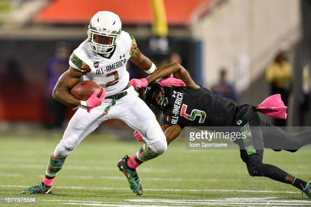 Team Flash wide receiver George Pickens breaks the tackle attempt by Team Ballaholics defensive back Te'Cory Couch during the Under Armour AllAmerica...
