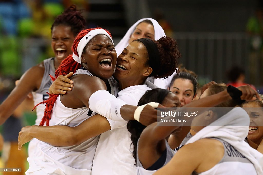 Team France celebrate after defeating Belarus 73-72 during a Women's Basketball Preliminary Round game at Youth Arena on August 7, 2016 in Rio de Janeiro, Brazil.