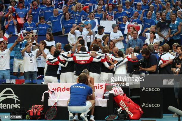 Team France celebrate their victory in the Fed Cup final tennis competition between Australia and France in Perth on November 10, 2019. / / IMAGE...