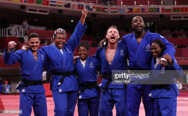Team France celebrate victory over Team Japan during the Mixed Team Final to claim the gold medal on day eight of the Tokyo 2020 Olympic Games at...