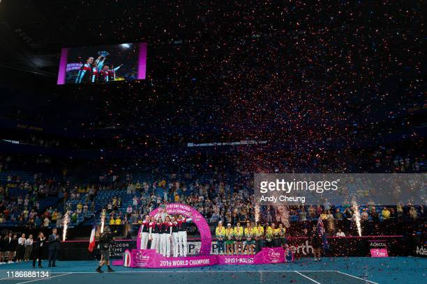 Team France celebrate while Team Australia look on after being defeated at the 2019 Fed Cup Final tie between Australia and France at RAC Arena on...