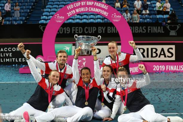 Team France celebrate winning the Fed Cup final tennis competition between Australia and France in Perth on November 10 2019 A jubilant Kristina...