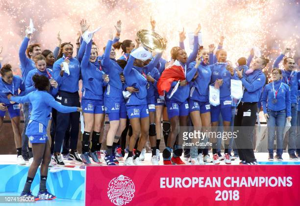 Team France celebrates the victory during the trophy ceremony following the EHF Women's Euro 2018 Final match between Russia and France at...