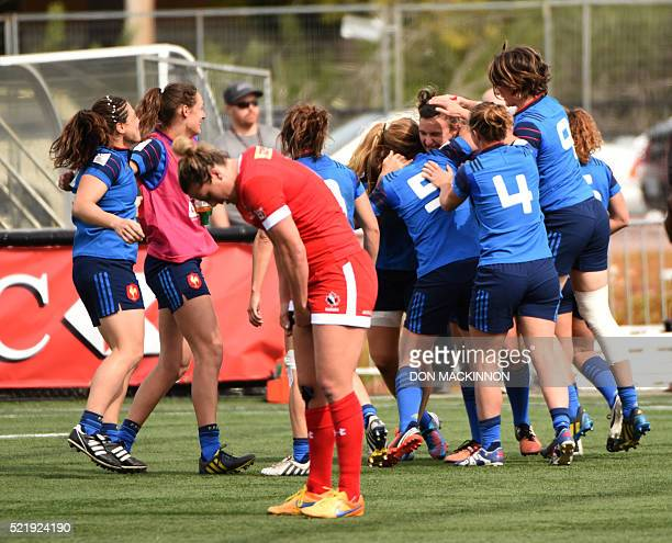 Team France rejoice after winning their match against Canada 1412 in HSBC World Rugby Women's Sevens Series in Langford BC on April 17 2016 / AFP...