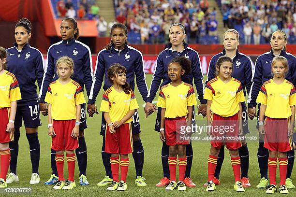 Team France stand in line during the national anthem prior to the FIFA Women's World Cup Canada 2015 round of 16 match between France and Korea...