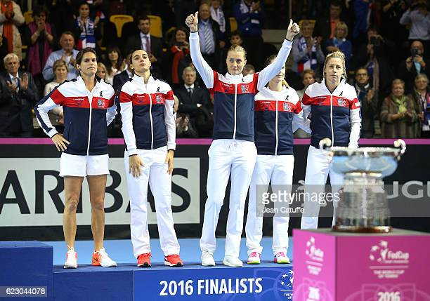 Team France with captain Amelie Mauresmo Caroline Garcia Kristina Mladenovic Alize Cornet Pauline Parmentier pose during the trophy ceremony...