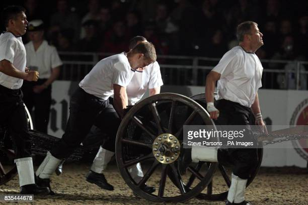 A team from HMNB Portsmouth Hampshire competes in the Royal Naval Field Gun run at the Windsor Castle Royal Tattoo in the grounds of the Castle in...