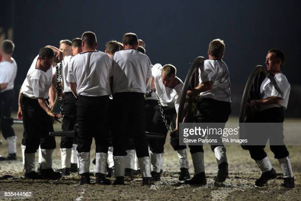 A team from HMS Sultan from GosportHampshire competes in the Royal Naval Field Gun run at the Windsor Castle Royal Tattoo in the grounds of the...