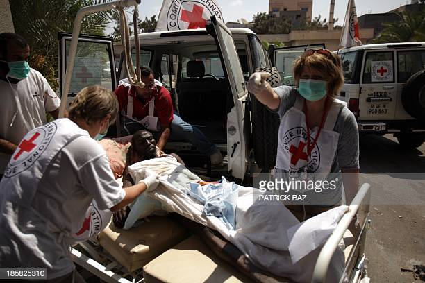 A team from the International Committee of the Red Cross ready to evacuate injured people from the general hospital in the restive Abu Salim...