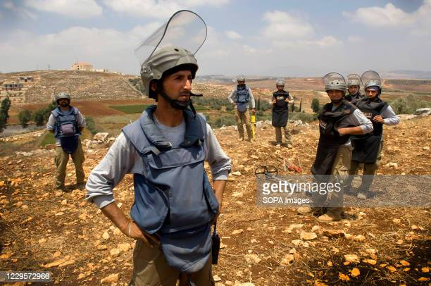 Team from the Mines Advisory Group are seen clearing unexploited cluster munitions in the farmland of southern Lebanon. Decades of war have left...