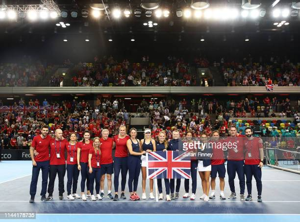 Team GB celebrate after Katie Boulter of Great Britain defeated Zarina Diyas of Kazakhstan to win the tie during the Fed Cup World Group II PlayOff...