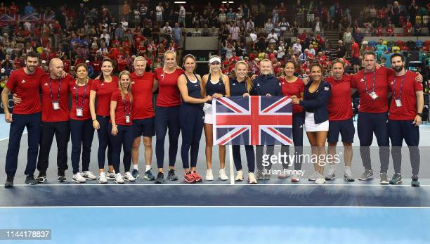 Team GB celebrate after Katie Boulter of Great Britain defeated Zarina Diyas of Kazakhstan to win the tie during the Fed Cup World Group II Play-Off...