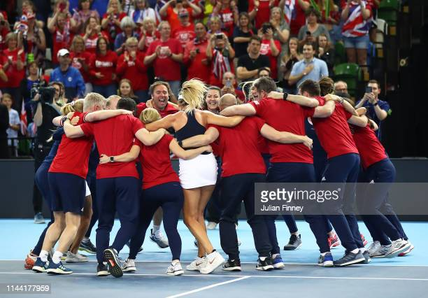Team GB celebrate Katie Boulter of Great Britain defeating Zarina Diyas of Kazakhstan to win the tie during the Fed Cup World Group II Play-Off match...