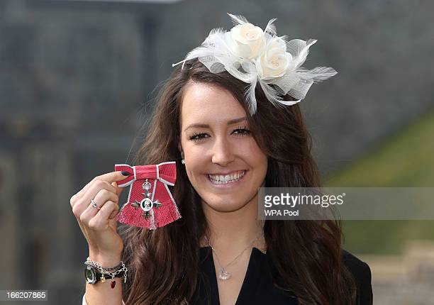 Team GB cyclist Danielle King poses with her MBE after an Investiture ceremony at Windsor Castle on April 10 2013 in Windsor England