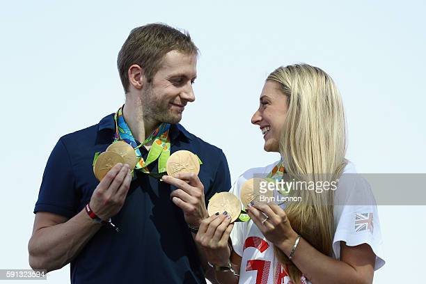 Team GB cyclists Laura Trott and Jason Kenny pose with their gold medals at Adidas House on August 17 2016 in Rio de Janeiro Brazil