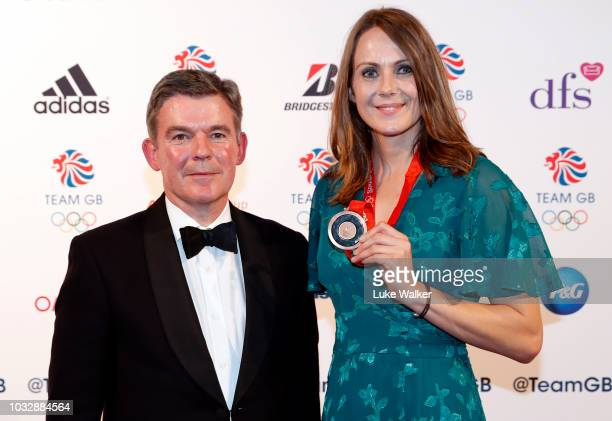 Team GB heptathlete Kelly Sotherton receives her bronze medal from the 2008 Olympics and Sir Hugh Robertson attends The Team GB Ball 2018 held at The...