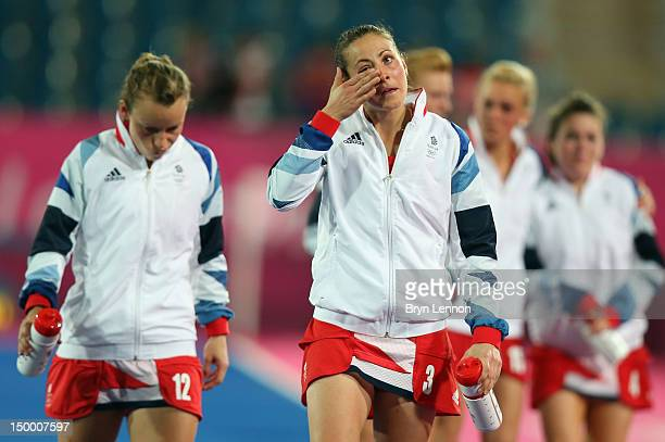 Team GB leave the pitch after losing to Argentina in the Women's Hockey semifinal match between Argentina and Great Britain on Day 12 of the London...