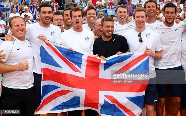 Team GB Matt Little Colin Fleming Leon Smith Ross Hutchins Andy Murray Daniel Evans Jonny Marray Colin Beecher and James Ward celebrate during day...