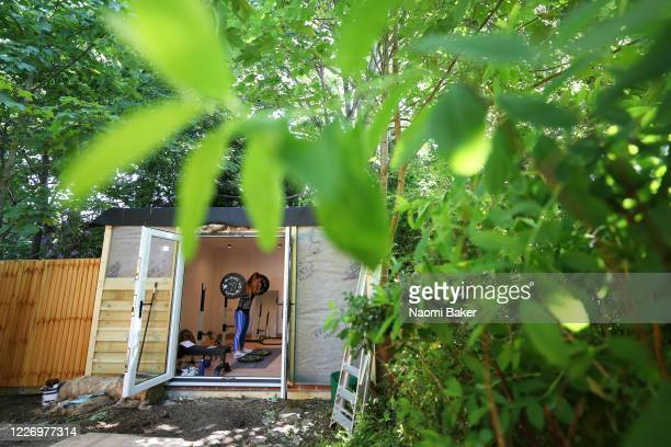 Team GB Paralympian Ali Smith trains in a gym at the end of her Garden at her home in Liphook on May 25 2020 in Liphook England