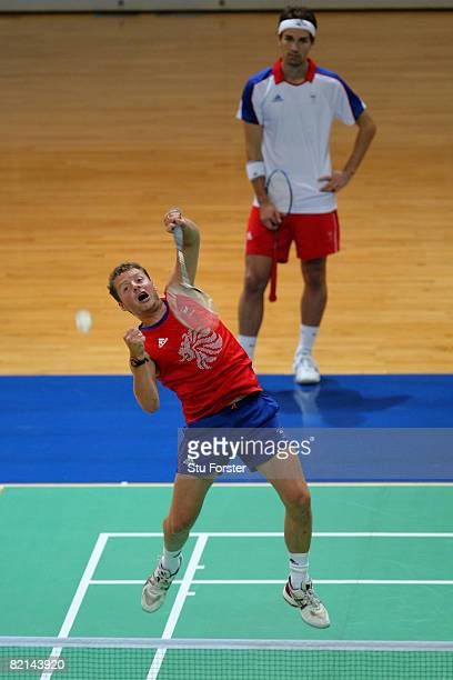 Team GB player Nathan Robertson watches as his doubles partner Anthony Clark plays a smash shot during Team GB Badminton training at the Macau...