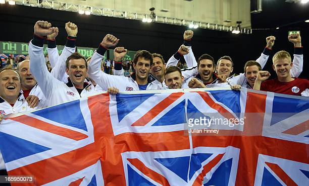 Team GB players James Ward Colin Fleming Jonathan Marray Dan Evans of Great Britain and Captain Leon Smith celebrate defeating Russia during day...
