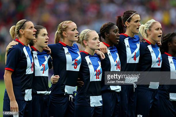 Team GB players sing the national anthem before the Women's Football first round Group E Match between Great Britain and Brazil on Day 4 of the...