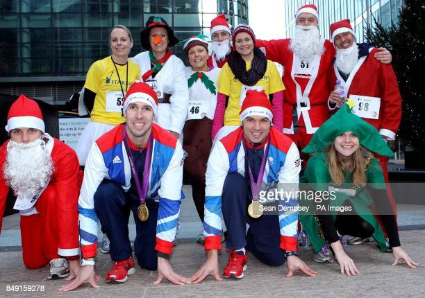 Team GB Slalom canoeists Etienne Stott and Tim Baillie with runners from Mangroup at the beginning of Starlight's Twelve Days of Christmas Run...
