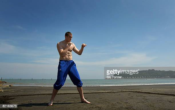 Team GB Super Heavyweight boxer David Price shadow boxes on the beach at the Team GB Headquarters at the Westin Hotel on August 3 2008 in Macau China