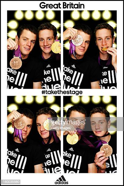 Team GB triathlete brothers Alistair Brownlee and Jonathan Brownlee poses for pictures with their Gold and Bronze Medal in the adidas photobooth on...