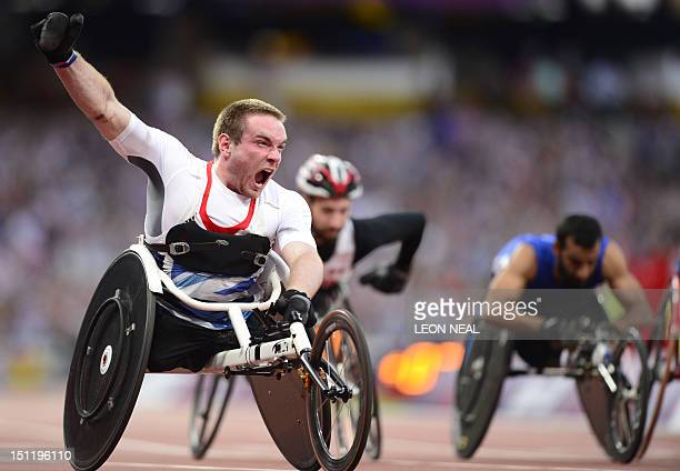 Team GB's Mickey Bushell celebrates after taking the gold medal in the men's 100m T53 at the Paralympic Games at the Olympic Park in east London on...