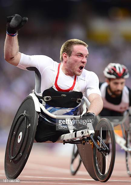 Team GB's Mickey Bushell celebrates after taking the gold medal in the men's 100m T53 at the Paralympic Games at the Olympic Park in east London...