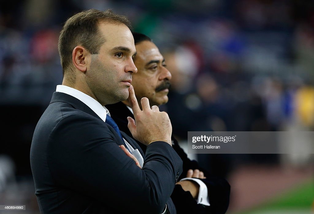 Team general manager David Caldwell (L) chats with Shahid Khan, the owner of the Jacksonville Jaguars on the field before their game against the Houston Texans at NRG Stadium on December 28, 2014 in Houston, Texas.