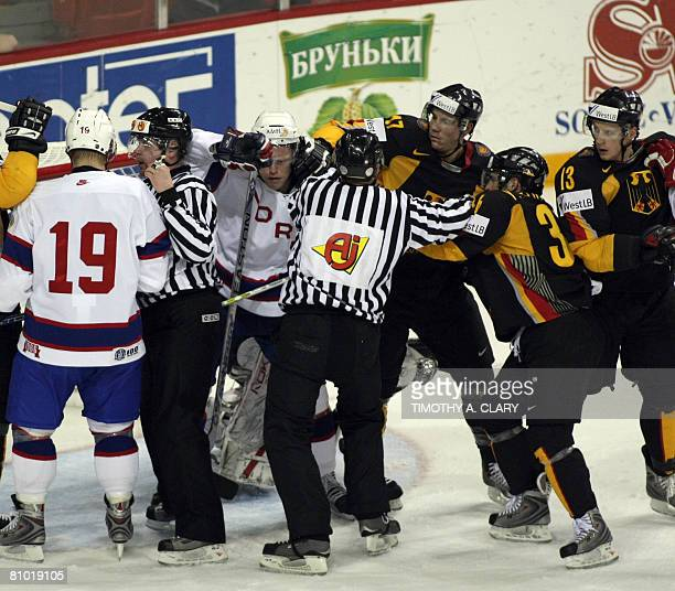 Team Germany battles Team Norway around the goal during the preliminary round of the 2008 IIHF World Hockey Championships at the Halifax Metro Centre...