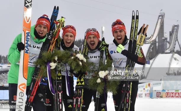 Team Germany Bjoern Kircheisen, Eric Frenzel, Fabian Riessle and Johannes Rydzek pose after they won the men's nordic combined NH Team Gundersen 4x5...