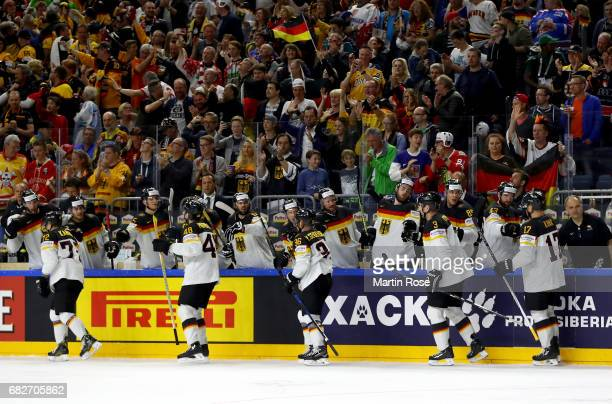 Team Germany celebrate their 3rd goal uring the 2017 IIHF Ice Hockey World Championship game between Italy and Germany at Lanxess Arena on May 13...