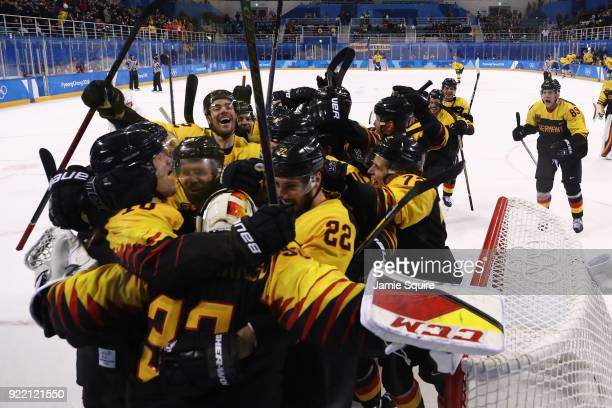Team Germany celebrates after defeating Sweden 43 in overtime during the Men's Playoffs Quarterfinals game on day twelve of the PyeongChang 2018...