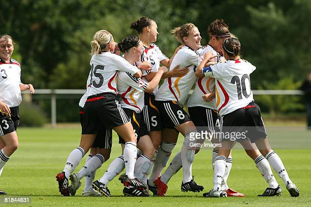 Team Germany celebrates after scoring the first goal for Germany during the Women's U19 European Championship match between Germany and England at...