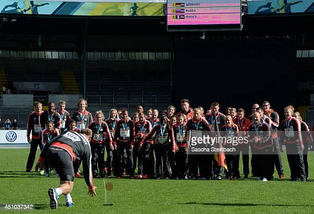 Team Germany celebrates after winning the European Athletics Team Championship at Eintracht Stadion on June 22 2014 in Braunschweig Germany