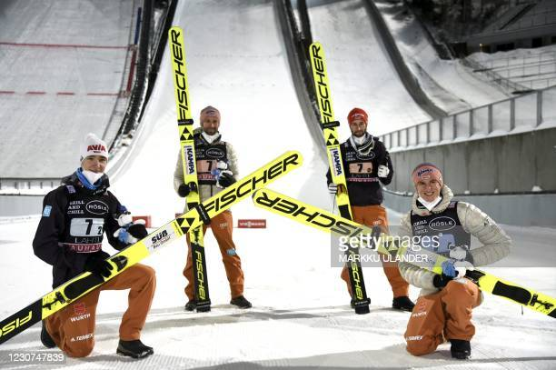 Team Germany composed by Martin Hamann, Pius Paschke, Markus Eisenbichler and Karl Geiger pose for a picture after winning the third place of the Ski...