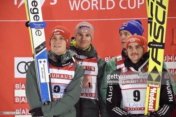 Team Germany of Stephan Leyhe Karl Geiger Andreas Wellinger and Richard Freitag celebrate after the ski jumping Team competition at the FIS World Cup...
