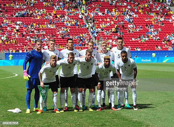 Team Germany poses for a group photo before playing against Portugal during the Men's Football Quarterfinal match on Day 8 of the Rio 2016 Olympic...