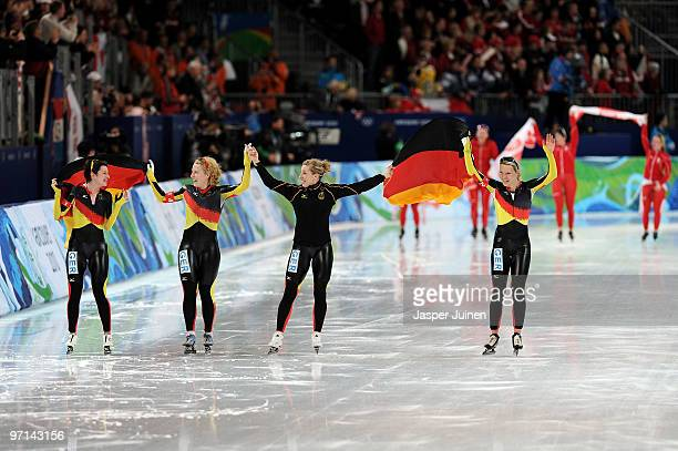 Team Germany with Daniela Anschutz Thoms Stephanie Beckert Anna FriesingerPostma and Katrin Mattscherodt celebrate the gold medal in the ladies' team...