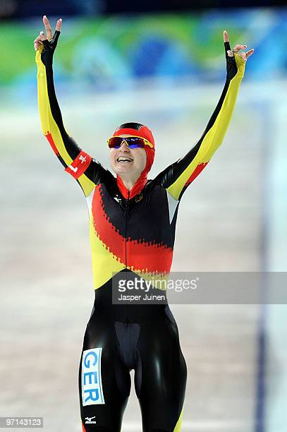 Team Germany's Daniela Anschutz Thoms celebrates the gold medal in the ladies' team pursuit finals on day 16 of the 2010 Vancouver Winter Olympics at...
