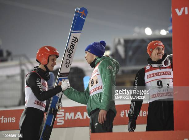 Team Germany's last jumper Stephan Leyhe Andreas Wellinger and Richard Freitag react after the ski jumping Team competition at the FIS World Cup...