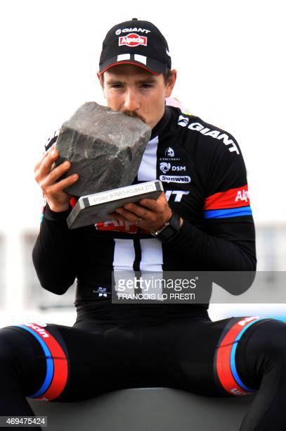 Team Giant-Alpecin German cyclist John Degenkolb celebrates on the podium after winning the 113th edition of the Paris-Roubaix Paris-Roubaix one-day...