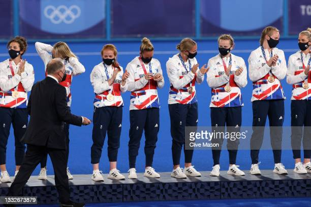 Team Great Britain applaud with their Bronze Medals during the Victory Ceremony following the Women's Gold Medal match between Netherlands and...