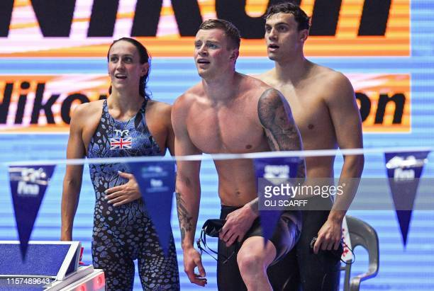 Team Great Britain Britain's Georgia Davies Britain's Adam Peatyand Britain's James Guy react after taking bronze in the final of the mixed 4x100m...
