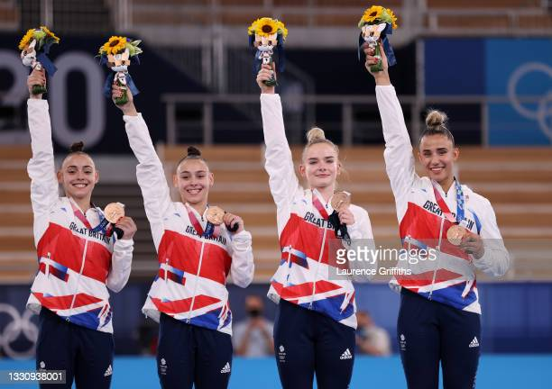 Team Great Britain celebrate on the podium after winning the bronze medal during the Women's Team Final on day four on day four of the Tokyo 2020...