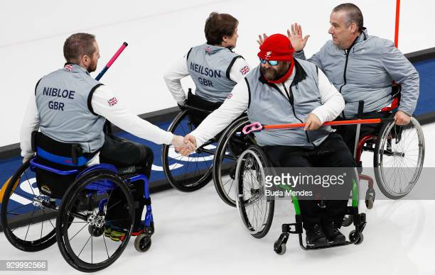 Team Great Britain celebrate the victory in the Wheelchair Curling Round Robin Session 01 during day one of the PyeongChang 2018 Paralympic Games at...