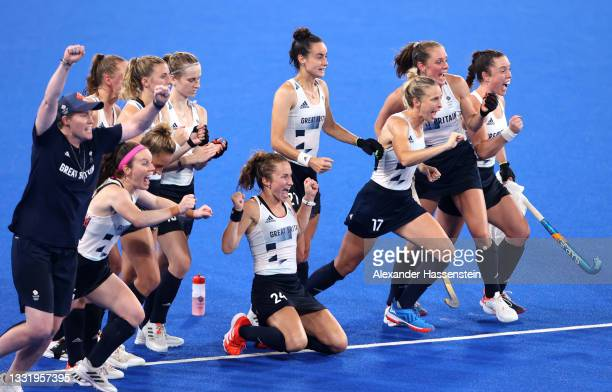 Team Great Britain celebrate victory in the Women's Quarterfinal match between Spain and Great Britain on day ten of the Tokyo 2020 Olympic Games at...